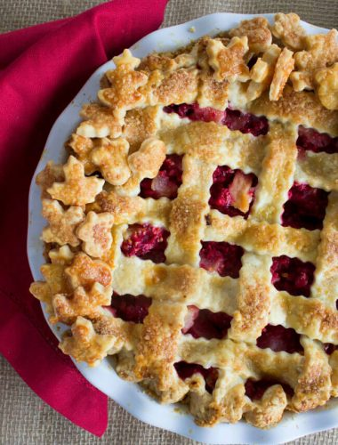 This Pear Cranberry Pie is the perfect balance of sweet, tender pears and tart, fresh cranberries encased in an all-butter, flaky, crisp crust. Plus, there's a touch of fresh ginger that gives this fruit pie a bright, fresh taste. It's the perfect non-traditional pie to celebrate Thanksgiving.