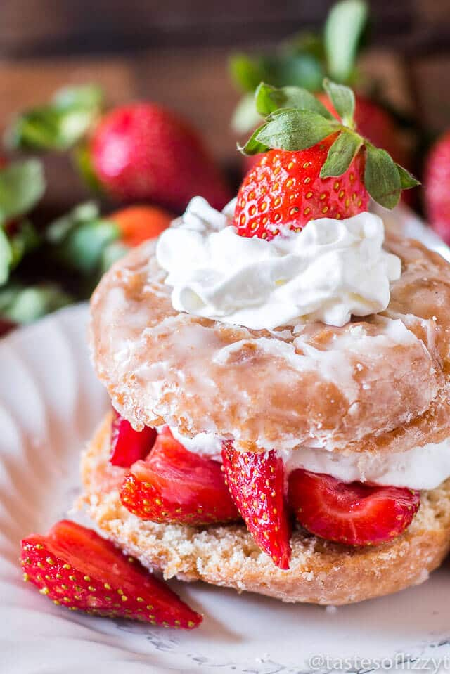 Donut Strawberry Shortcake. Strawberries in syrup top a sliced donut ...