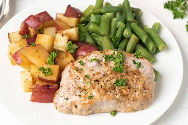 pork chops, green beans and potatoes