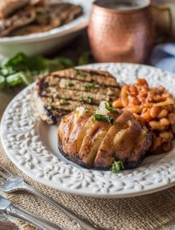 Just 3 ingredients and less than 30 minutes for until these Hasselback Italian-style Grilled Baked Potatoes with onions are on your picnic table.