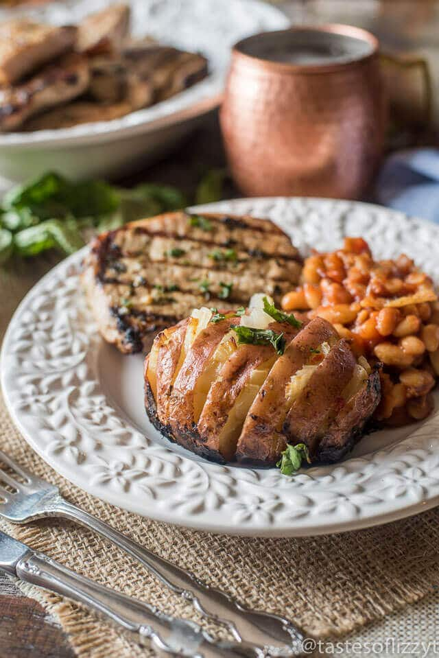 ... -style Grilled Baked Potatoes with onions are on your picnic table