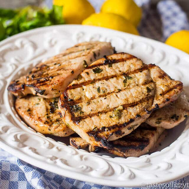 juicy grilled pork chops on a serving plate