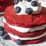 stack of red velvet pancakes with blueberries
