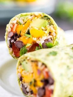 Vegetarian Burritos with beans, rice, chipotle chili sauce and mango avocado salsa, all wrapped in a homemade spinach tortilla! Easy dinner idea for summer!