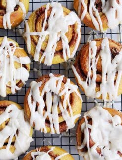 Pumpkin spice cinnamon buns are so pillowy soft and pair perfectly with the gooey spiced dark brown sugar filling. Drizzled with maple butter cream cheese frosting.