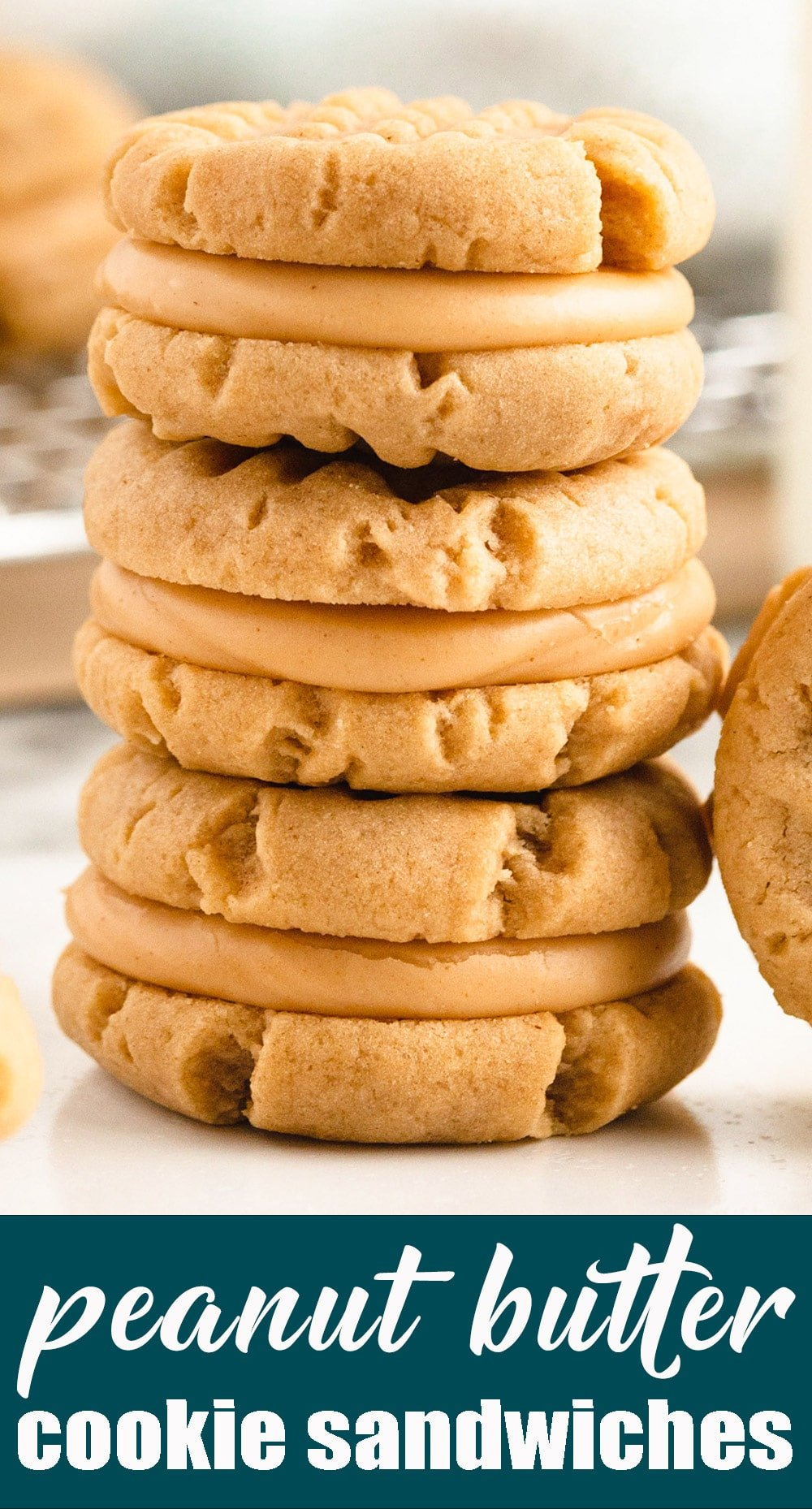 Soft, peanut butter sandwich cookies filled with a sweet peanut butter cream. These bite-size cookies from Amish country are perfect for gift giving. via @tastesoflizzyt