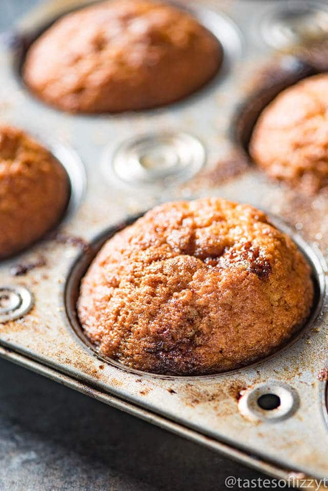 close up of cinnamon muffin in a muffin pan