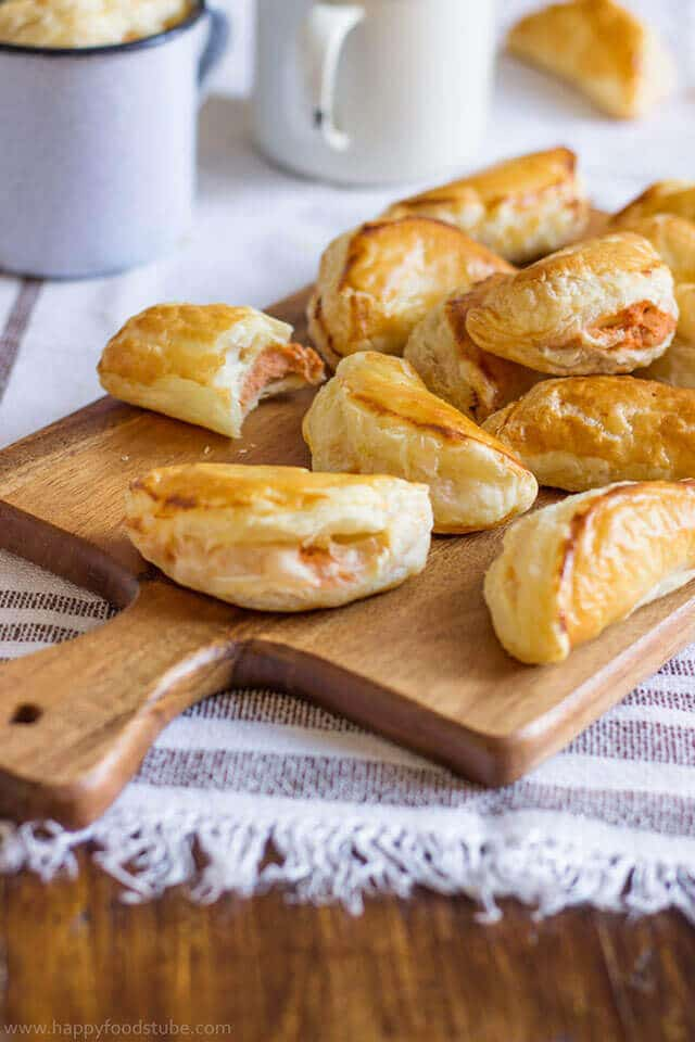 Food on a wooden table, with tuna empanadas