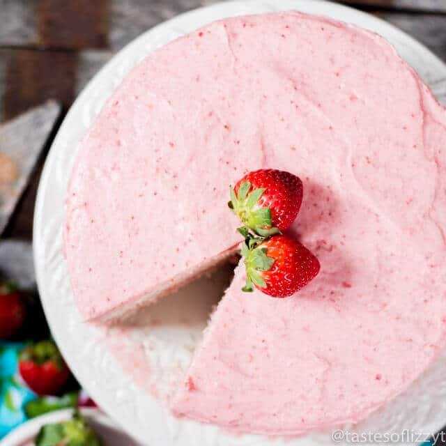 strawberry cake with a slice missing