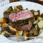 A close up of a plate of food, with Steak and potatoes