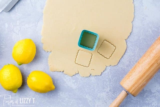 lemon shortbread dough rolled out with cookie cutter on it