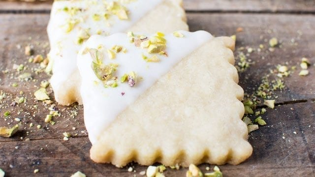 square cut lemon shortbread cookie dipped in white chocolate and pistachio