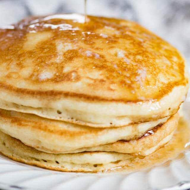 stack of sourdough pancakes with syrup