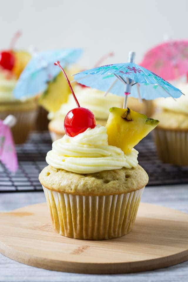 cupcake with a cherry and umbrella