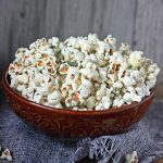 A bowl of food, with Popcorn