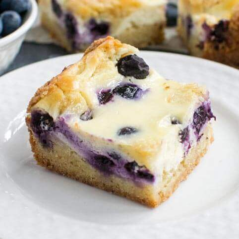 blueberry cheesecake bar on a plate