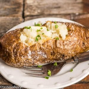 crispy skinned oven-baked potato topped with butter and chives