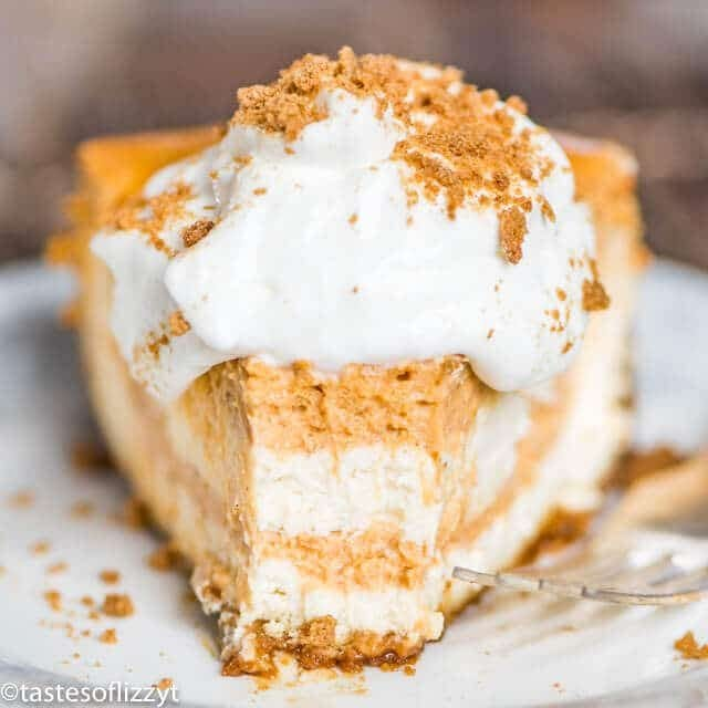 slice of pumpkin swirl cheesecake with a bite out