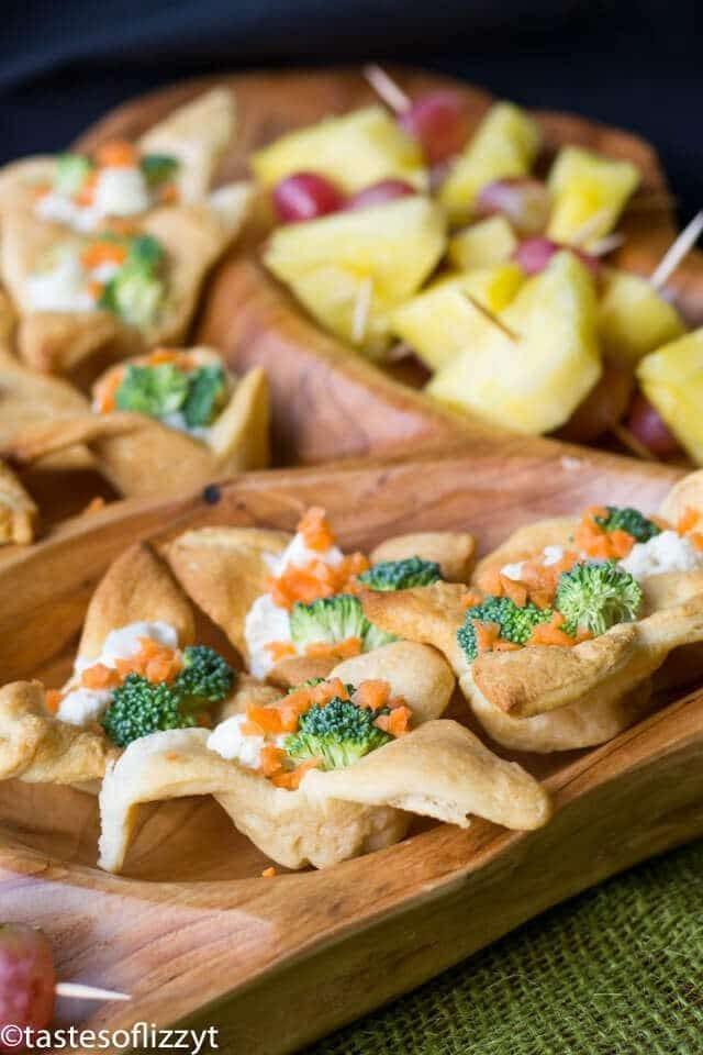 mini veggie pizza appetizers on a platter