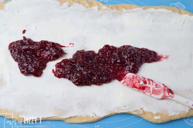 raspberry and cream cheese spread on dough