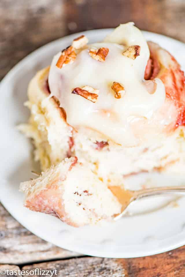 raspberry cheesecake rolls with frosting
