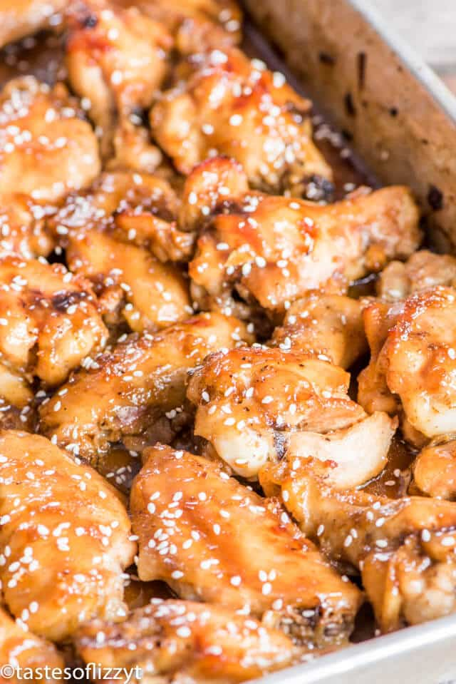 A close up of chicken wings in baking pan