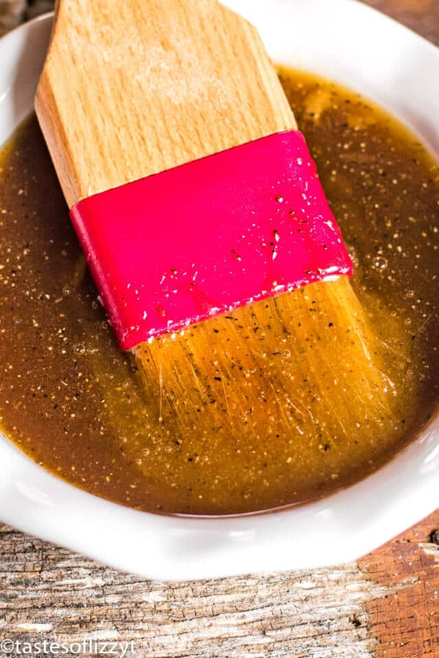 ham glaze in a bowl with a pastry brush