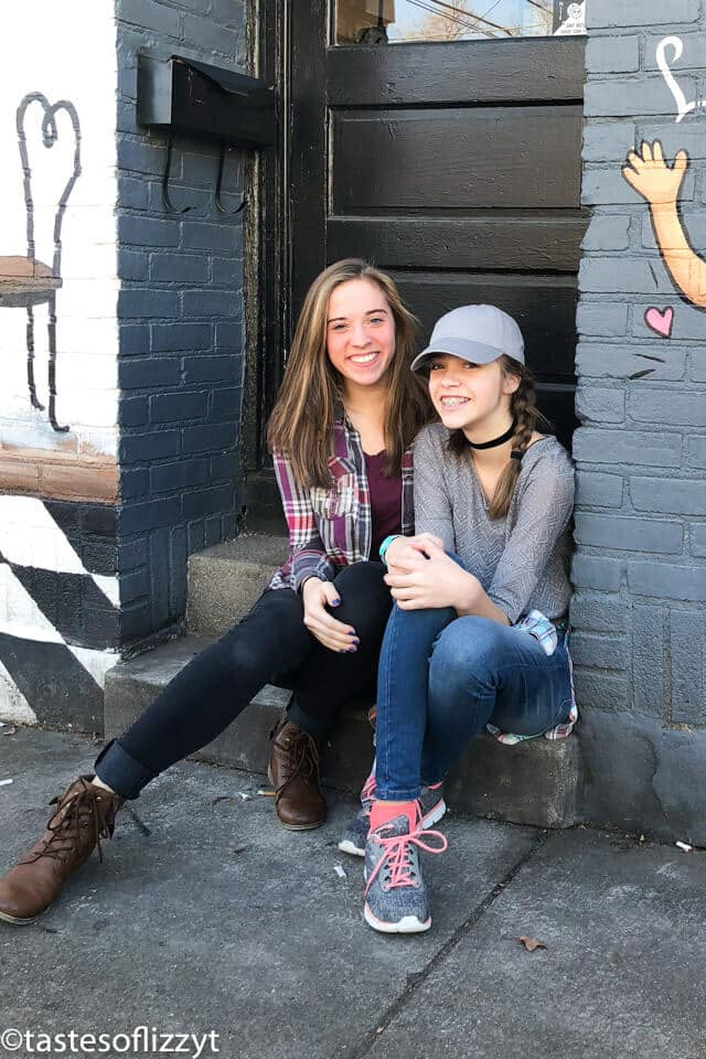 sisters sitting on cement steps