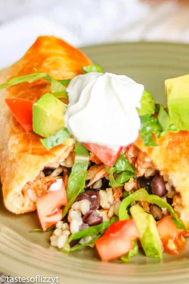 A close up of a plate of food, with Chimichanga and Chicken