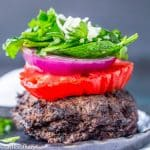 low carb burger with lettuce onion and tomato