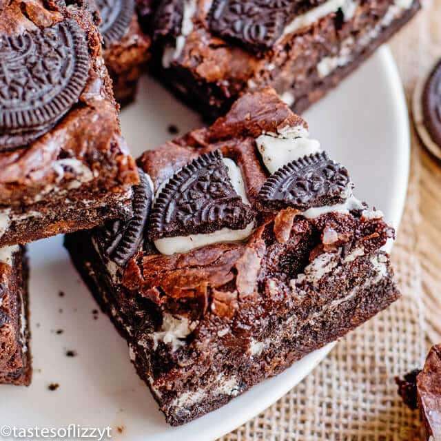 plate of chocolate brownies with oreos on top