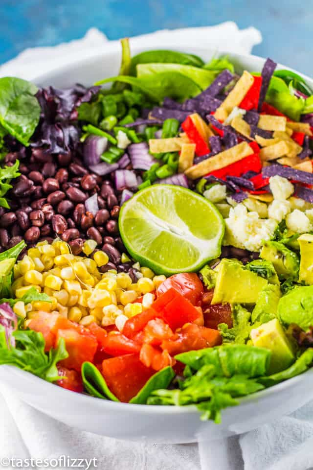 A bowl of fruit and vegetable salad, with Taco salad
