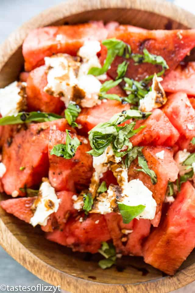 A close up of a bowl of watermelon salad