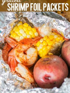 Whether you are camping or cooking at home, these easy grilled shrimp foil packets with fresh corn and potatoes are a quick 30 minute dinner recipe.