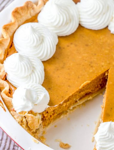 Homemade Pumpkin Pie with a slice removed
