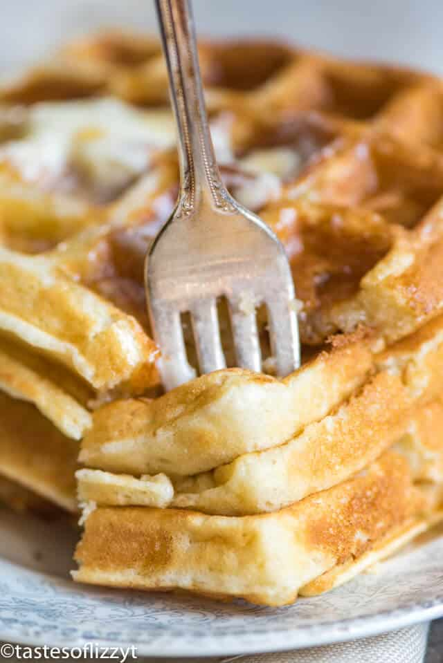 stack of belgian waffles with a fork