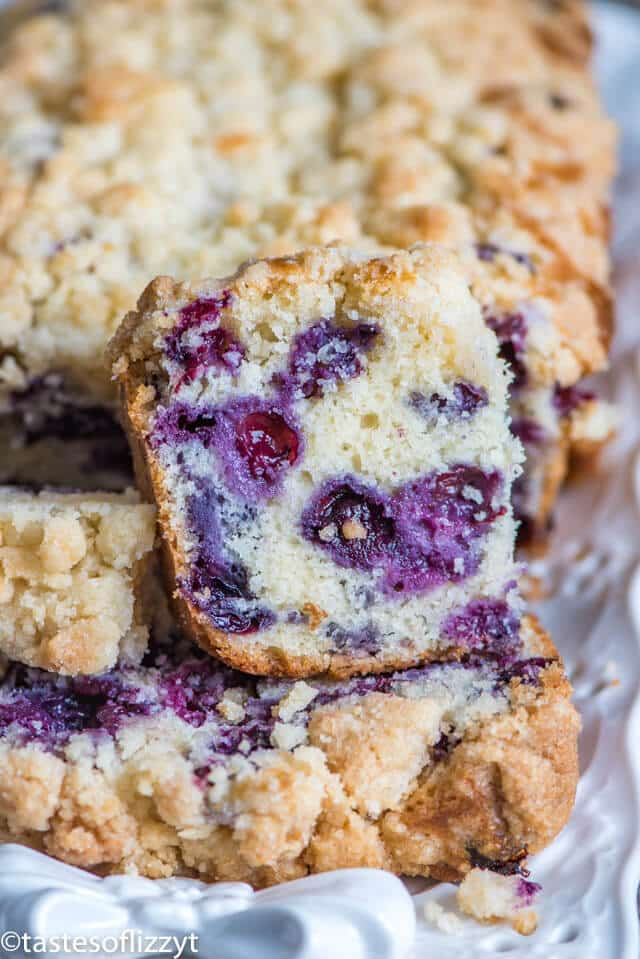a piece of blueberry bread with streusel on top