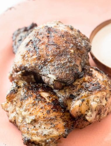 How to grill chicken thighs with simple flavoring. Serve low carb white barbecue sauce alongside this easy chicken thigh recipe for a delicious dinner!