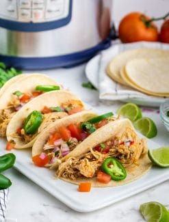 chicken tacos on a table with an instant pot