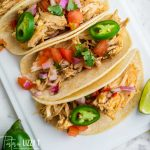 overhead view of shredded chicken tacos