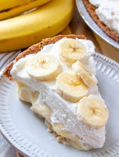 A sliced banana cream pie on a plate