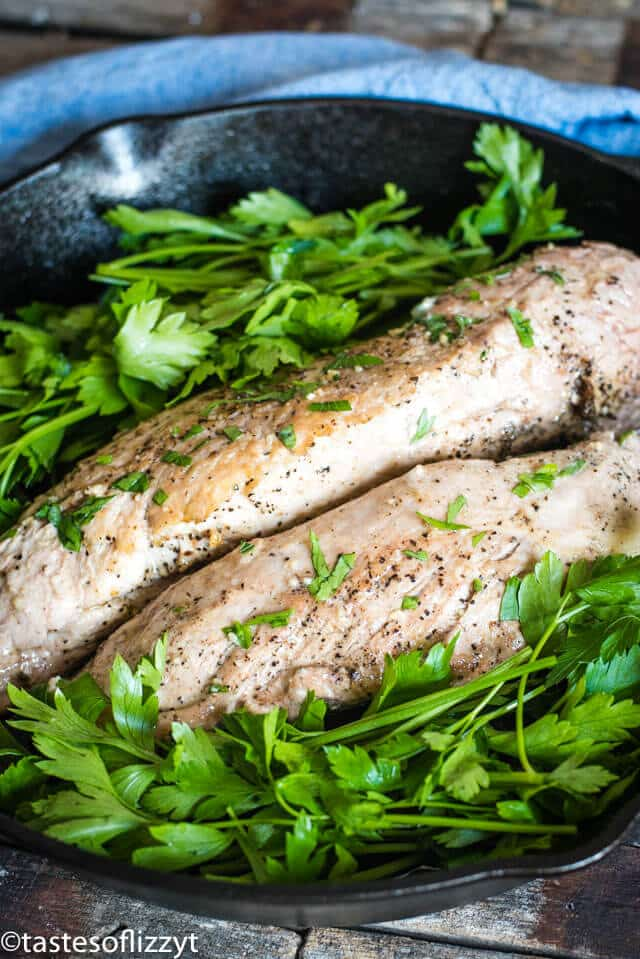 pork tenderloin in a skillet with parsley