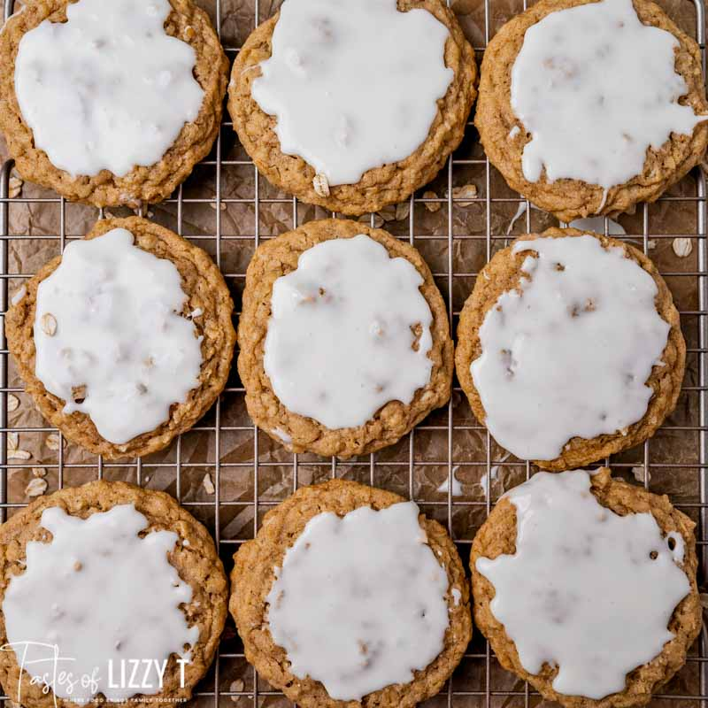 iced oatmeal cookies on a cooling rack
