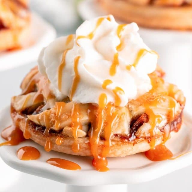 mini apple pie with ice cream and whipped cream