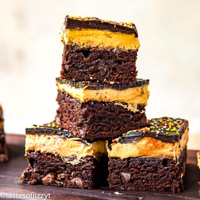 stack of chocolate brownies with pumpkin cheesecake