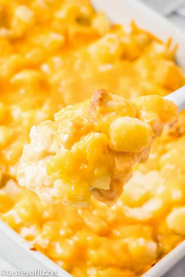 cheesy potato casserole on a spoon