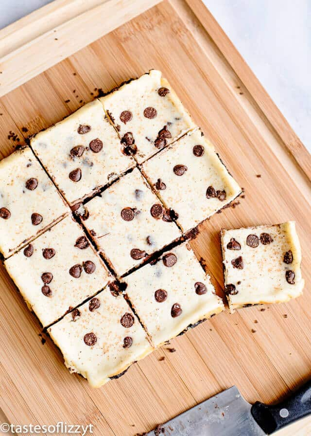 eggnog bars with chocolate chips on a cutting board
