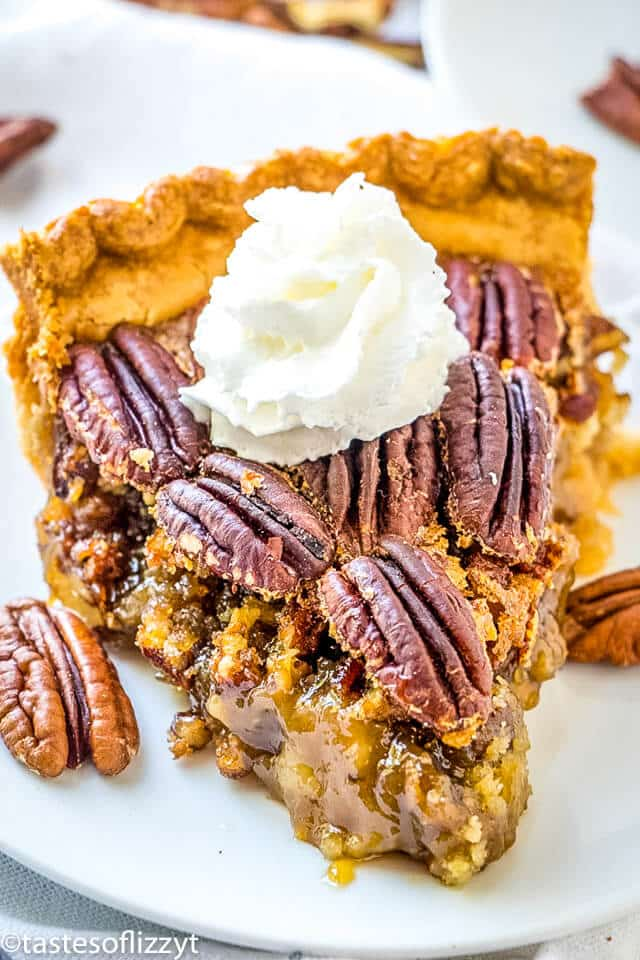 A piece of pecan pie on a plate
