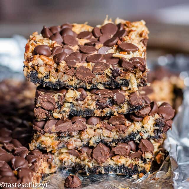 stack of magic cookie bars with an Oreo cookie crust