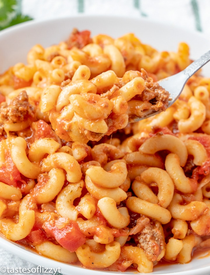 macaroni and beef in a bowl with a fork